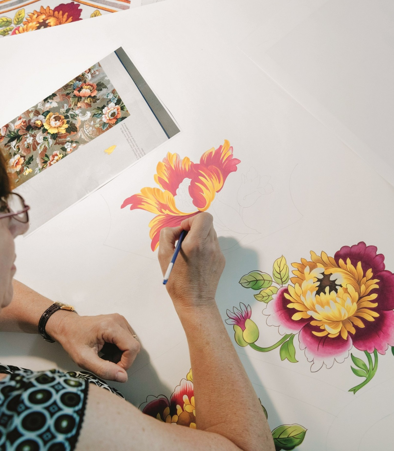 A floral design is painted on paper