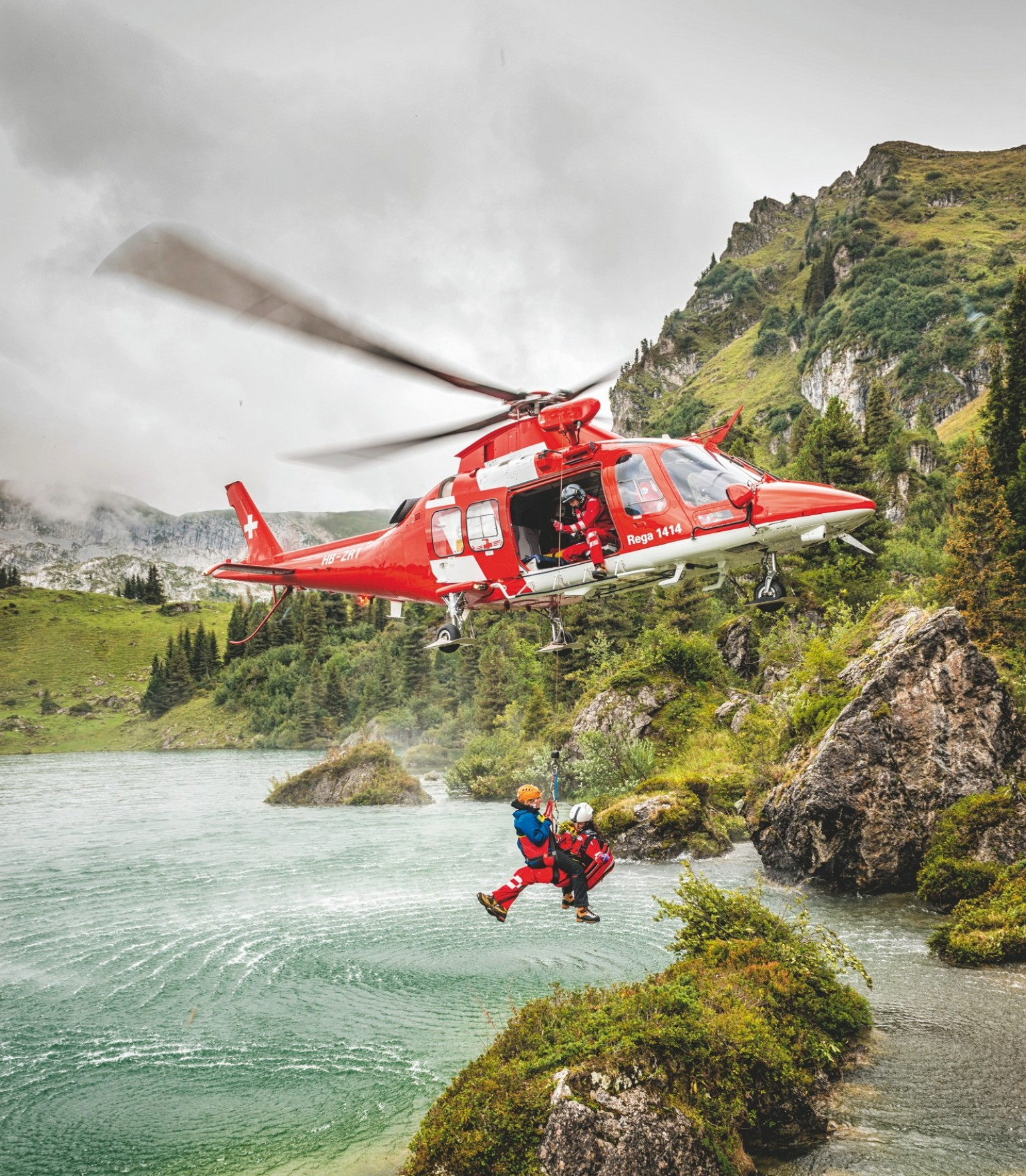 A Rega Challenger helicopter rescue in the Alps