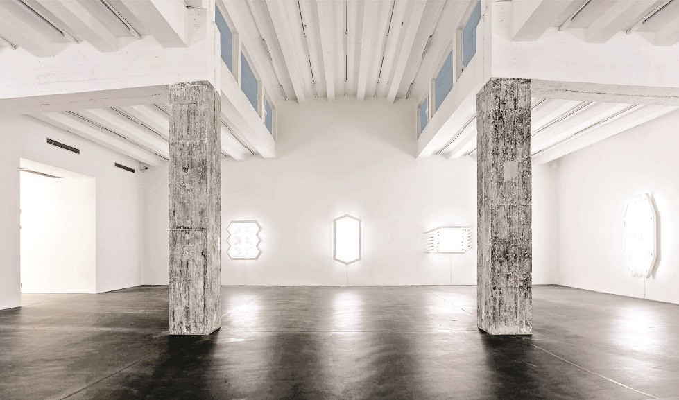A white room filled with installations of light.
