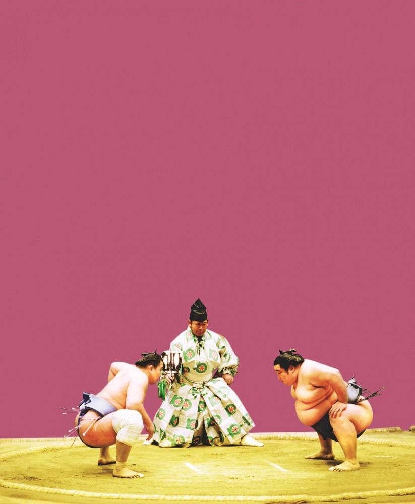 Two sumo wrestlers prepare for battle.