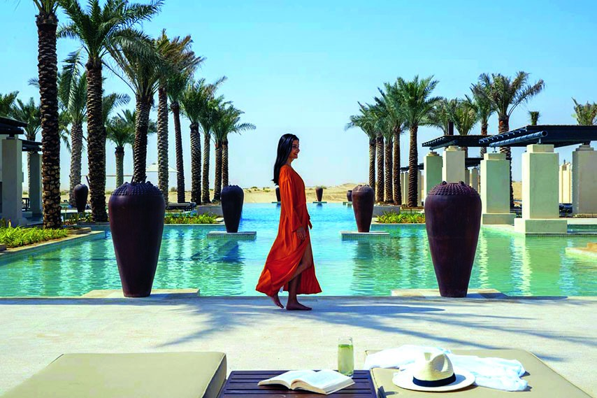 Woman walking at the Qasr Al Sarab resort in Abu Dhabi