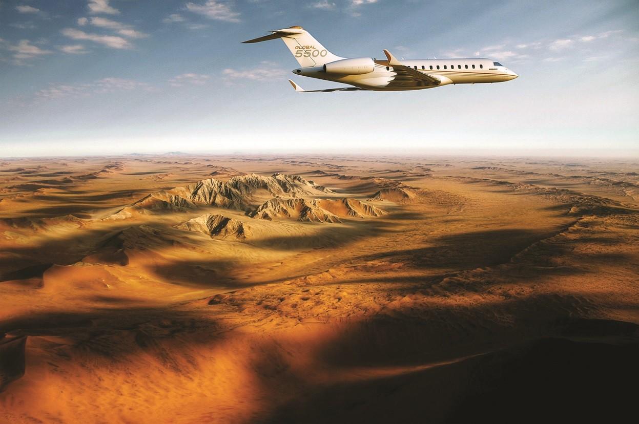 A Global 5500 jet flies over the desert